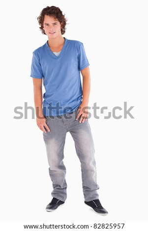 Cheerful handsome man posing in a studio