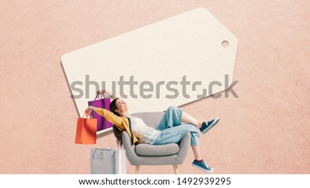 Cheerful happy shopaholic woman with lots of shopping bags and blank price tag, sales and offers concept