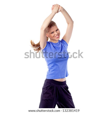 Cheerful happy woman dancing with arms raised. Energetic, Active Caucasian model enjoy aerobics/ fitness. Isolated on white background