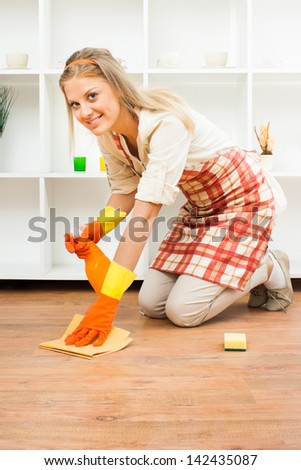 Cheerful housewife enjoys in cleaning,It`s time for cleaning