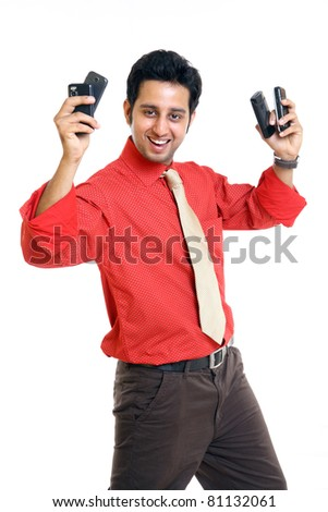 Cheerful Indian businessman with variety cell pones