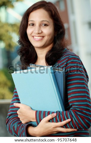 Cheerful indian female college student