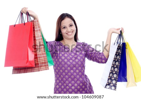 Cheerful Indian woman with shopping bags - stock photo