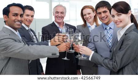 Cheerful international business people celebrating a sucess with Champagne