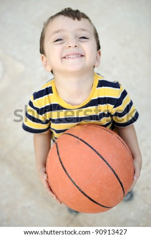 Cheerful kid with basket ball