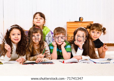 Cheerful kids crowd reading books