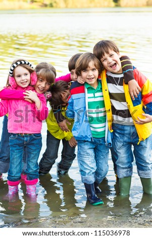 Cheerful kids group in rubber boots