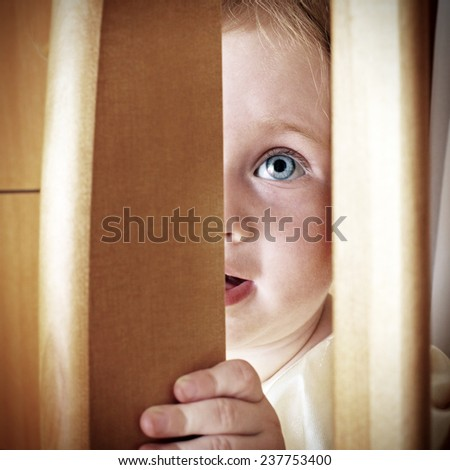 Cheerful Little Baby Playing Hide and Seek
