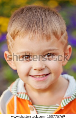 Cheerful little boy. Close-up portrait.