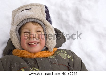 cheerful little boy enjoy winter outdoor