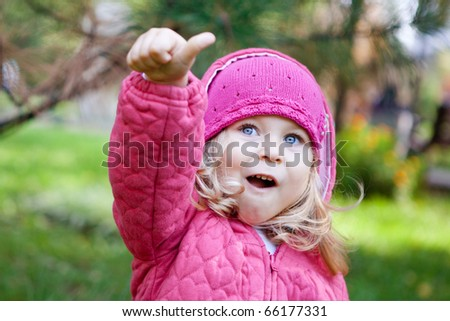 Cheerful little girl  dressed in pink