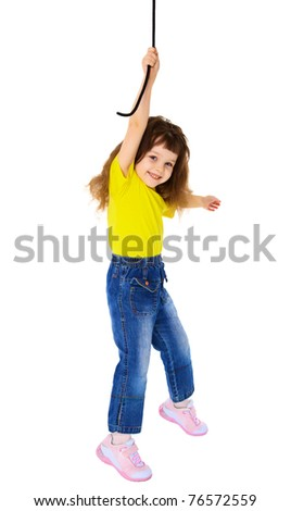 Cheerful little girl hanging on a rope isolated on white background