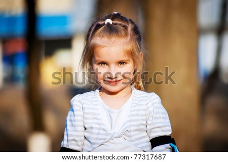 Cheerful little girl looks into the camera