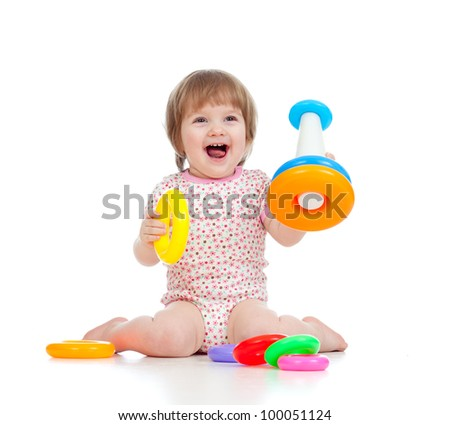 cheerful little girl playing with colorful toy isolated on white