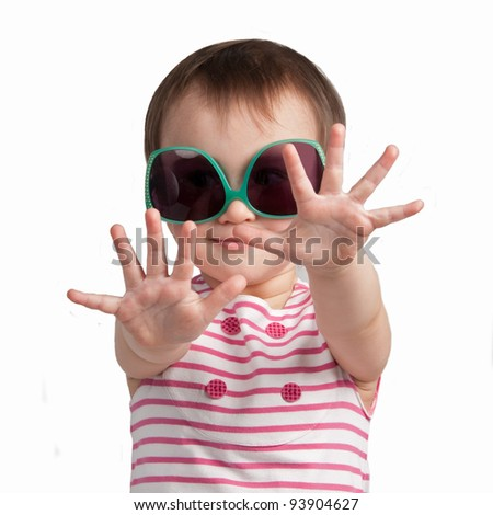Cheerful little girl wearing glamorous glasses isolated