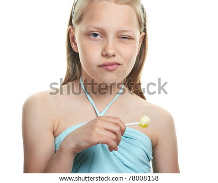 Cheerful little girl with lollipop on white