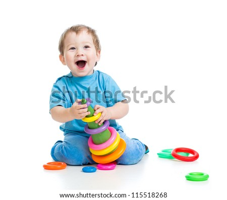 cheerful little kid boy playing with colorful toy isolated on white