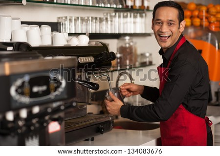 Cheerful male staff preparing customers order.