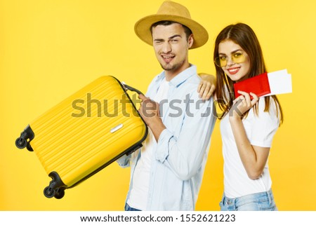 Cheerful man and woman suitcase passport and plane tickets vacation vacation summer