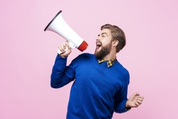 Cheerful man shouting into megaphone