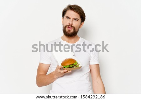 Cheerful man T-shirt hamburger fast food diet meal snack meal