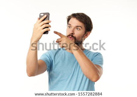 Cheerful man with a phone in the hands of the provision of services device smartphones device #1557282884