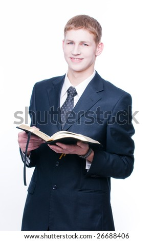 Cheerful man with Bible, isolated on white background