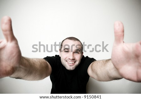 Cheerful man with open arms - focus on the face.