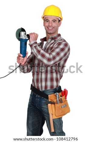 Cheerful manual worker holding angle grinder