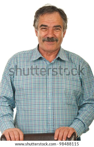 Cheerful mature business man standing with hands on seat chair isolated on white background - stock photo