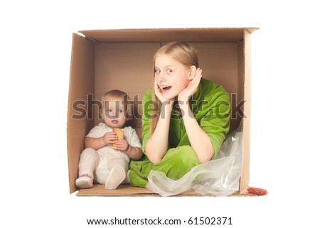cheerful mother sit in box with baby eating cookie