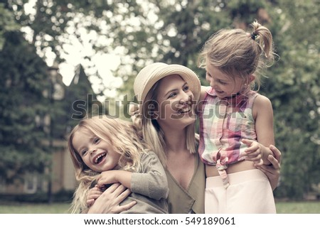cheerful mother with her...
