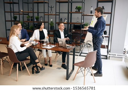 cheerful motivated man gaving recommendations, advise to run startup business, discussion, workshop