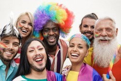 Cheerful multiracial people from different generations at gay pride parade - Concept of lgbt and homosexual love