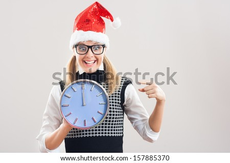 Cheerful nerd is showing on the clock that  it`s midnight and a new year is here,Excited nerd