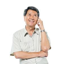 Cheerful Old Asian Man Thinking