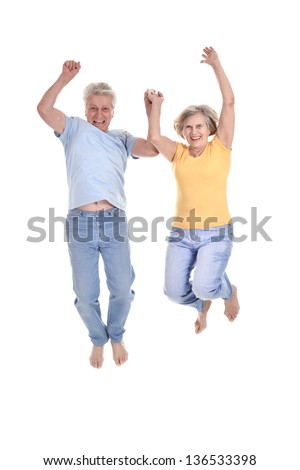 cheerful old couple jumping on a white background