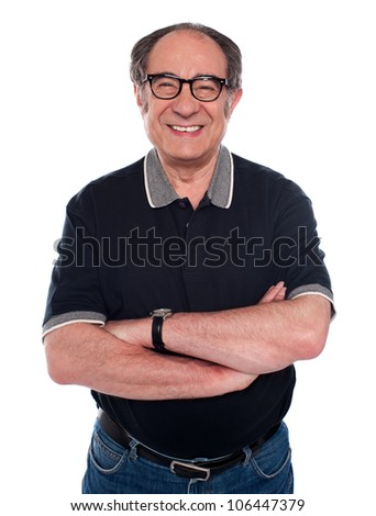 Cheerful old man standing with arms crossed against white background