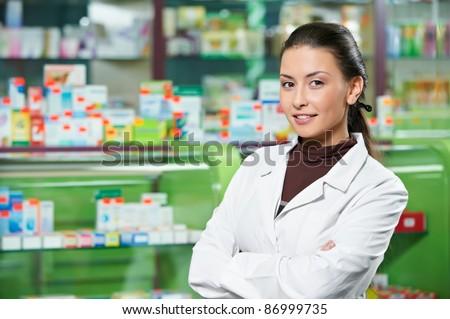 cheerful pharmacist chemist woman standing in pharmacy drugstore