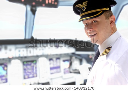 Cheerful pilot controls the aircraft in the cockpit
