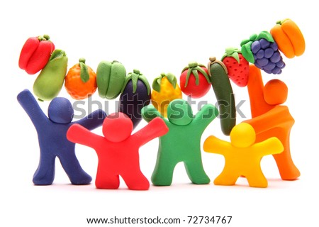 cheerful plasticine guys celebrating healthy food of vegetables and fruits