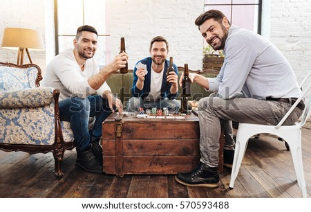 Cheerful positive men playing card games #570593488
