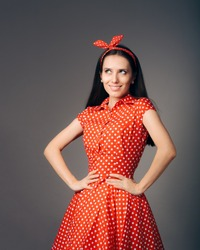 Cheerful Retro Woman in Polka Dots Rockabilly Dress. Woman wearing vintage dress with sassy attitude