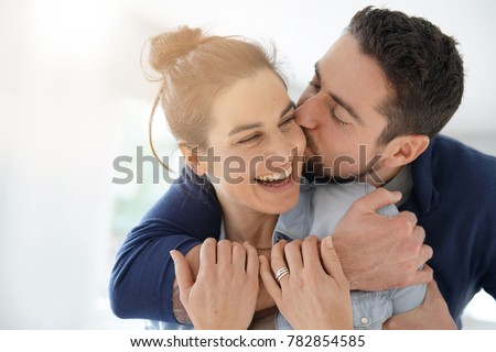 Cheerful romantic couple of lovers cuddling