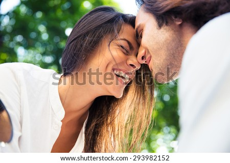Cheerful romantic couple outdoors