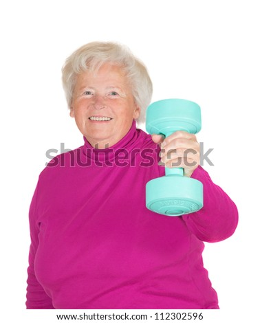 Cheerful senior woman lifting weights holding up a dumbbell in her flexed arm in a health and fitness concept