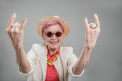 Cheerful senior woman posing in studio