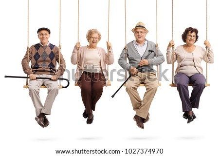 Cheerful seniors sitting on wooden swings and looking at the camera isolated on white background #1027374970