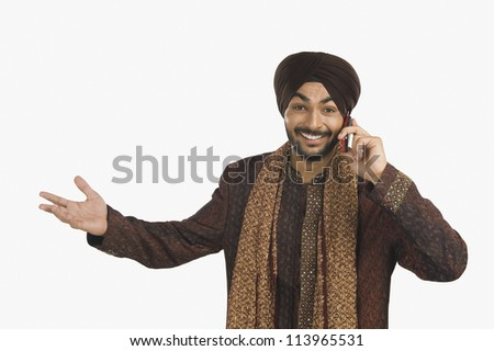 1352fe11ba Free photos Portrait of a South Indian man talking on a mobile phone ...