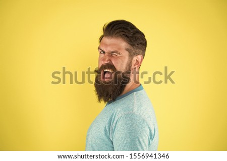 Cheerful smile. Man bearded hipster with mustache. Beard mustache grooming guide. Hipster handsome bearded guy yellow background. Barber shop concept. Growing and maintaining moustache. Grow mustache.